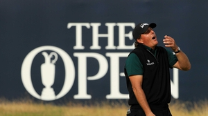 Mickelson reacts to his narrow miss on the last green