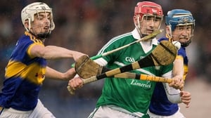 Tipperary's Ronan Maher and Paul Maher battle with Barry Nash of Limerick in Thurles