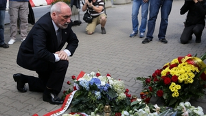Polish Defence Minister Antoni Macierewicz lays flowers in front of the French Embassy in Warsaw, Poland