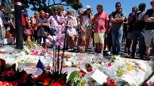 People gather near the scene of the attack in Nice