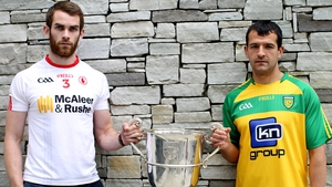 Tyrone's Ronan McNamee and Frank McGlynn of Donegal with the Anglo Celt Cup