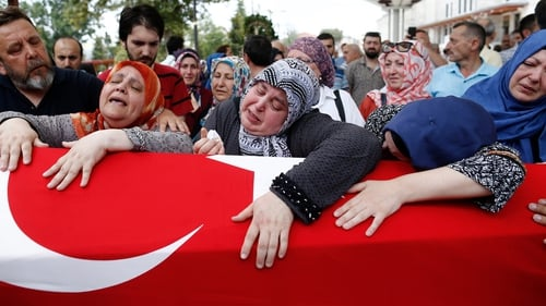 People mourn during the funeral of Omer Can Katar who was killed in the coup attempt