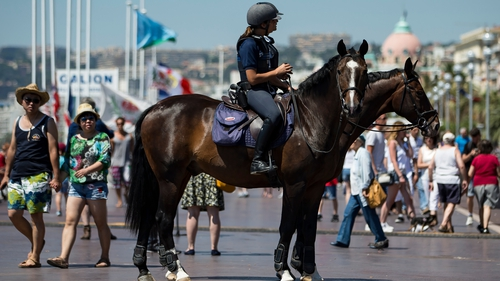 Mounted police patrol the Promenade des Anglais where the truck crashed into the crowd Thursday