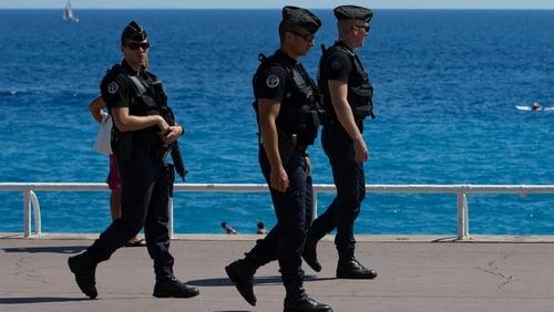 Gendarmes patrol on the Promenade des Anglais in Nice