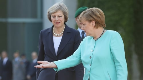 Angela Merkel (R) was speaking after Theresa May's (L) Sky News interview