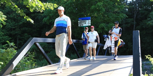 Dustin Johnson makes his way to the 12th tee