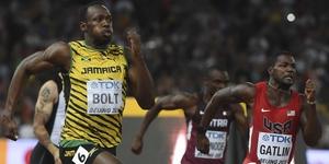 Usain Bolt and Justin Gatlin at the World Championships last year