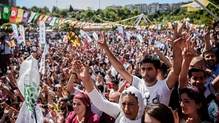 Pro-Kurdish supporters gather during a rally against the state of emergency, one week after the failed coup in Istanbul