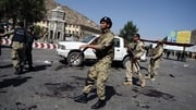 Afghan security personnel arrive on the scene after the suicide attack during a demonstration in Kabul
