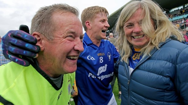 Colm Collins celebrates with his wife and Podge at full-time