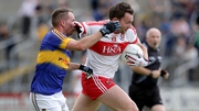 Derry's James Kielt fends off Tipp's Peter Acheson
