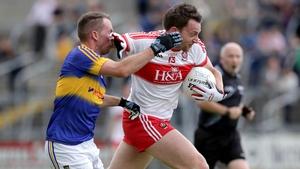 Derry's James Kielt fends off Tipp's Peter Acheson