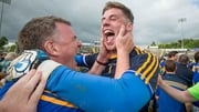 Tipperary manager Liam Kearns celebrates a famous win with Evan Comerford