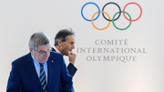 International Olympic Committee  president Thomas Bach (L) and IOC director general Christophe De Keepe