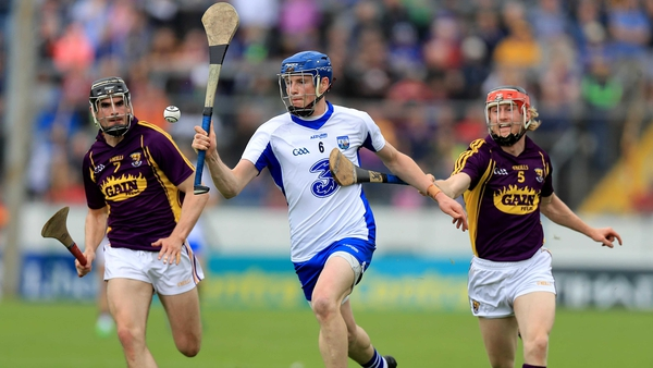Waterford's Austin Gleeson is pursued by Eanna Martin and Diarmuid O'Keeffe