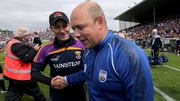 Vanquished Wexford manager Liam Dunne congratulates Derek McGrath after the game