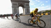 Chris Froome passes the Arc de Triomph yesterday