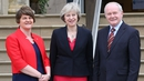 Theresa May is greeted by First Minister Arlene Foster and Deputy First Minister Martin McGuinness at Stormont Castle