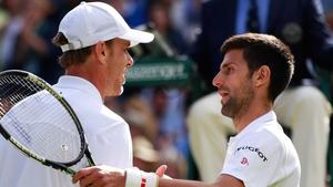 Sam Querrey with Novak Djokovic after his surprise defeat