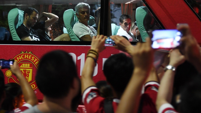 Jose Mourinho looks on as fans flock to the team bus