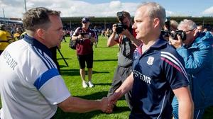 Davy Fitzgerald (L) congratulates Micheál Donoghue