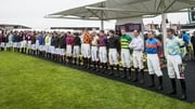 Jockeys stand for a minutes silence in memory of JT McNamara