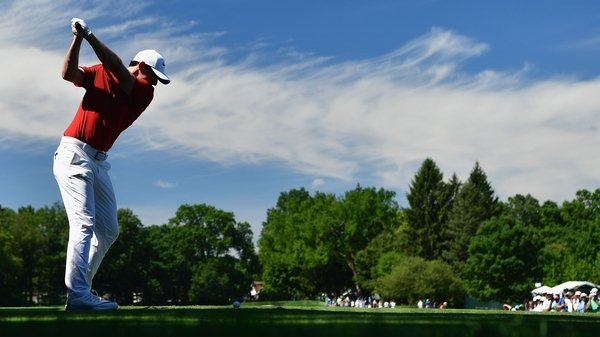 Rory McIlroy hits a tee shot during a practice round at Baltusrol Golf Club