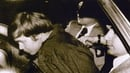 A 1981 file photo shows John Hinckley Jr (L) escorted by police following his arrest