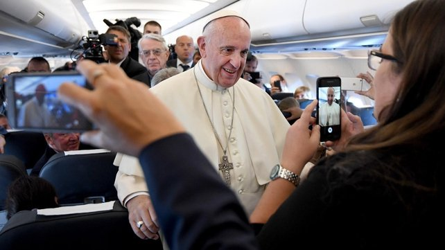 Pope Francis on board a plane during his flight to Balice Airport  in Krakow, Poland
