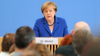 Merkel rejects calls to reverse refugee policy