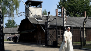 Pope Francis walks through the 'Arbeit macht Frei' main gate at Auschwitz