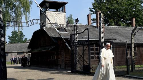Pope Francis walks through the 'Arbeit macht Frei' main gate at Auschwitz