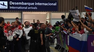 The Russian Olympic team are greeted upon their arrival in Rio de Janeiro