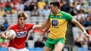 Cork's Ian McGuire with Rory Kavanagh of Donegal