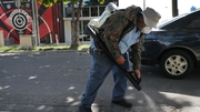 A mosquito control inspector sprays pesticide in a Miami neighbourhood