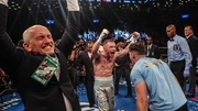 Carl Frampton (C) has won the belt that manager Barry McGuigan won back in 1985