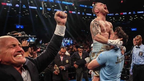 Carl Frampton celebrates with trainer Shane McGuigan and manager Barry McGuigan after the Santa Cruz decision in New York