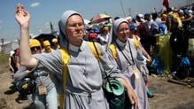 Pilgrims make their way home after the outdoor Mass