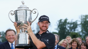Jimmy Walker hoists the Wanamaker Trophy after landing his maiden major in New Jersey