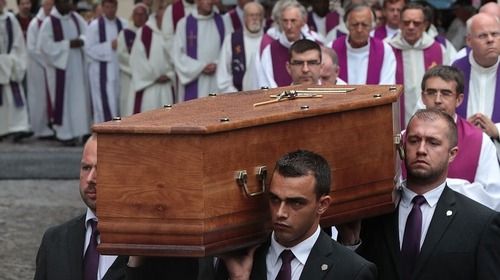 Pallbearers carry the coffin of the priest Jacques Hamel as they enter in Rouen's cathedral