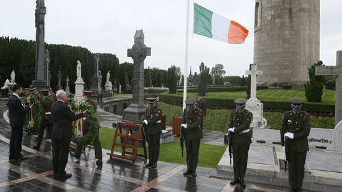 Minister Charlie Flanagan lays a wreath at Glasnevin Cemetery to commemorate the centenary of the execution of Roger Casement
