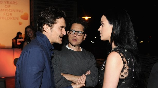 Orlando Bloom and Katy Perry pictured with JJ Abrams in April 2013