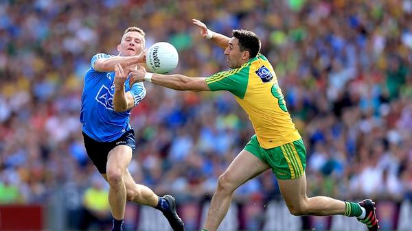 Dublin's Ciaran Kilkenny with Rory Kavanagh of Donegal