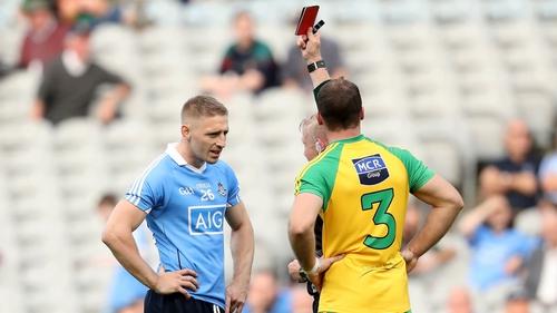 Eoghan O'Gara is shown a red card