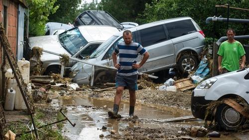 A man walks through a flooded street in the village of Stajkovci, near Skopje