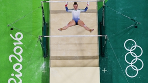 Ireland's Ellis O'Reilly hangs between the the uneven bars. She recorded a final score of 47.932 in all-round qualifying