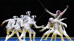 En garde! A multiple exposure image of American Alexander Massialas during his defeat of Russia's Artur Akhmatkhuzin in the men's Individual Foil