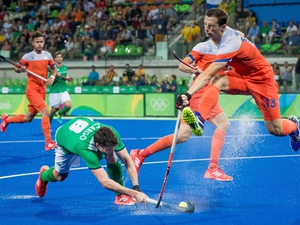 Ireland's Chris Cargo clashes with Sander Baart of the Netherlands. The Green Machine lost 5-0 in their Pool B game