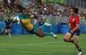 Ellia Green of Australia soars over for a try against as Spain's Patricia Garcia looks on during the Women's quarter-final