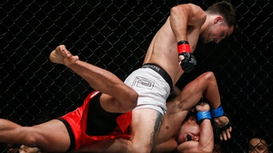 Jordan Lucas of Australia fights Edward Kelly of Philippines in an MMA One event in Myanmar